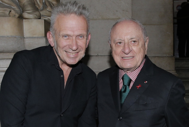 FILE - In this Sept.9 2012 file photo, French fashion designer Jean-Paul Gaultier, left, and Pierre Berge, in Paris. Pierre Berge, an influential French businessman and philanthropist who was fashion designer Yves Saint Laurent's romantic and business partner and championed gay rights, has died at 86. (AP Photo/Francois Mori, File)