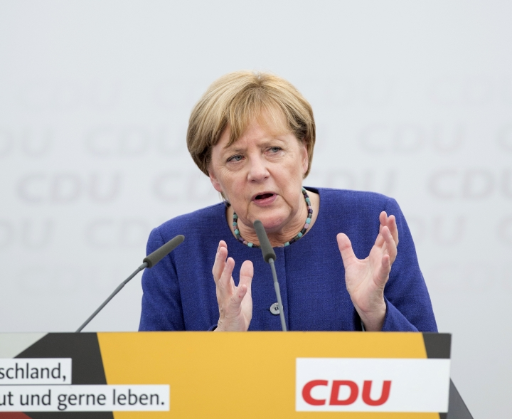 German Chancellor and top candidate of the Christian Democratic Union, CDU, Angela Merkel speaks during an election campaign in Delbrueck, western Germany, Sunday, Sept. 10, 2017. (Friso Gentsch/dpa via AP)