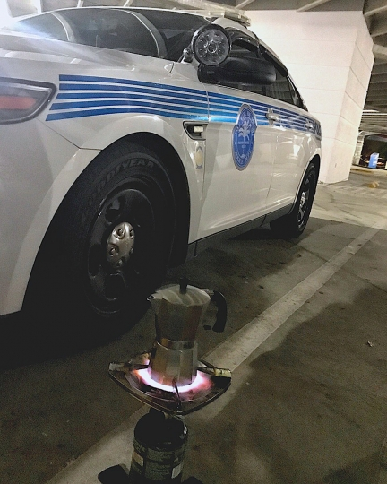 In this Saturday, Sept. 9, 2017 photo released by the Miami Police Department, a coffee pot sits on heat, in Miami. Some Miami Police officers remembered to pack an essential item in their hurricane survival pack: Cuban coffee, also known as cafecito. The police department tweeted a picture late Saturday showing a stovetop coffee maker atop a camp stove. (Miami Police Department via AP)