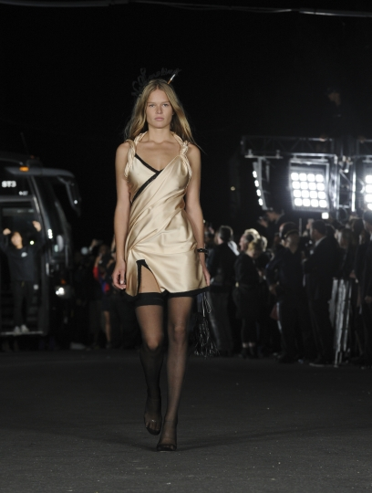 The Alexander Wang Spring 2018 collection is modeled on a street in the Bushwick neighborhood of Brooklyn during New York Fashion Week, Saturday, Sept. 9, 2017. (AP Photo/Diane Bondareff)