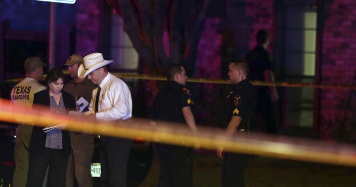Law enforcement officers and investigators gather outside the scene of a shooting in Plano, Texas, Sunday, Sept. 10, 2017. Authorities in North Texas say several people are dead, including the suspect, after a shooting at the Plano home. (AP Photo/LM Otero)