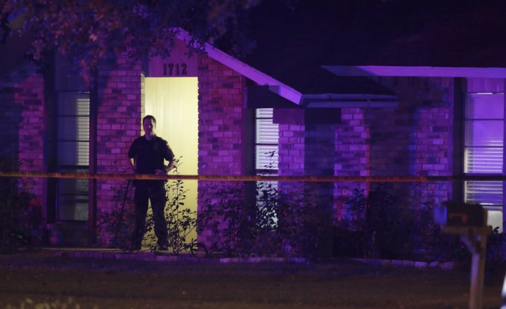 A police officer stands guard outside the scene of a mass shooting in Plano, Texas, Sunday, Sept. 10, 2017. Authorities in North Texas say several people are dead, including the suspect, after a shooting at the Plano home. (AP Photo/LM Otero)