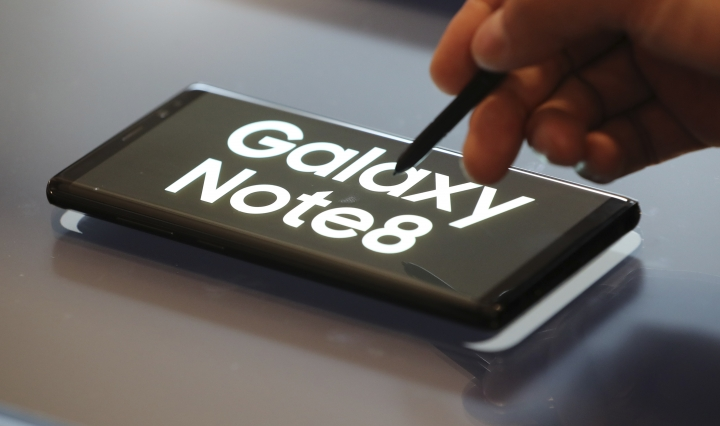 A man demonstrates Samsung Electronics' Galaxy Note 8 during a media day in Seoul, South Korea, Tuesday, Sept. 12, 2017. Samsung Electronics says its aims to launch a foldable smartphone next year under its Galaxy Note brand. Koh Dong-jin, president of mobile business at Samsung Electronics, said Tuesday that the company is currently setting its eyes on 2018 to release a smartphone with a bendable display but there are several hurdles it has to overcome. (AP Photo/Lee Jin-man)