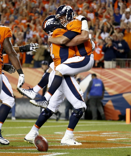 Denver Broncos quarterback Trevor Siemian, right, celebrates his touchdown run with offensive tackle Garett Bolles, left, during the first half of an NFL football game, Monday, Sept. 11, 2017, in Denver. (AP Photo/Jack Dempsey)