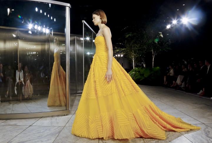 A model walks the runway during the Carolina Herrera fashion show as part of NYFW Spring/Summer 2018 on Monday, Sept. 11, 2017, in New York. (AP Photo/Bebeto Matthews)