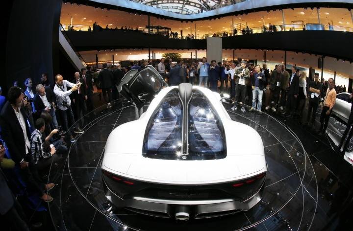 A Mercedes-AMG Project One is surrounded by visitors during the first media day of the International Frankfurt Motor Show IAA in Frankfurt, Germany, Tuesday, Sept. 12, 2017, which runs through Sept. 24, 2017. (AP Photo/Michael Probst)