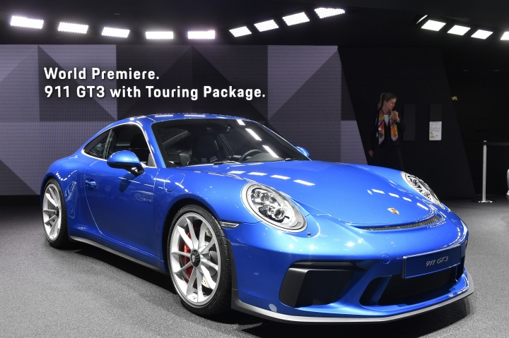 A Porsche 911 GT3 with Touring Package is on display during an event of German car maker Volkswagen on the eve of the opening of the International Frankfurt Motor Show IAA in Frankfurt, Germany, Monday, Sept. 11, 2017, which runs through Sept. 24, 2017. (AP Photo/Martin Meissner)