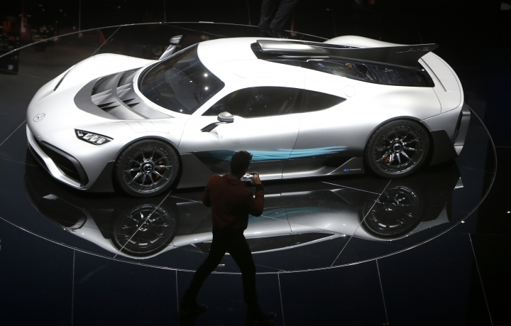 Formula One driver Lewis Hamilton films the Mercedes-AMG Project One hyper after the world premiere during an event of German carmaker Mercedes-Benz on the eve of the opening of the International Frankfurt Motor Show IAA in Frankfurt, Germany, Monday, Sept. 11, 2017, which runs through Sept. 24, 2017. (AP Photo/Michael Probst)