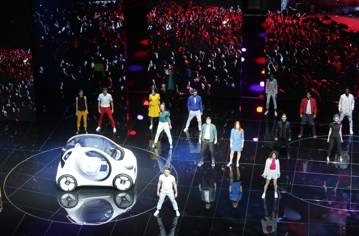 Models present the Smart vision EQ fortwo at a presentation of Mercedes-Benz on the first media day of the International Frankfurt Motor Show IAA in Frankfurt, Germany, Tuesday, Sept. 12, 2017, which runs through Sept. 24, 2017. (AP Photo/Michael Probst)