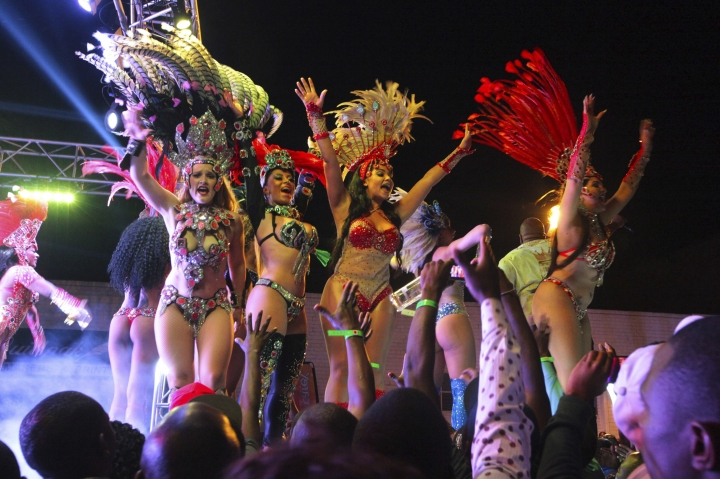 In this picture taken Friday, September, 8, 2017, Brazilan Samba dancers perform on stage during the Harare International Carnival in the capital. An international carnival aimed at boosting the local tourism industry has ended in economically troubled Zimbabwe. Some viewed the Harare festivities, which ended Sunday and featured artists and dancers from Brazil, Cuba, Egypt and elsewhere, as a relief from the struggle to get by in the southern African country. (AP Photo/Tsvangirayi Mukwazhi)