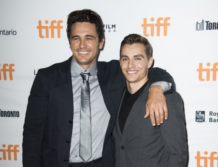 "FILE - In this Sept. 11, 2017 file photo, director James Franco, left, and his actor brother Dave Franco attend a premiere for ""The Disaster Artist"" on day 5 of the Toronto International Film Festival in Toronto. (Photo by Arthur Mola/Invision/AP, File)"