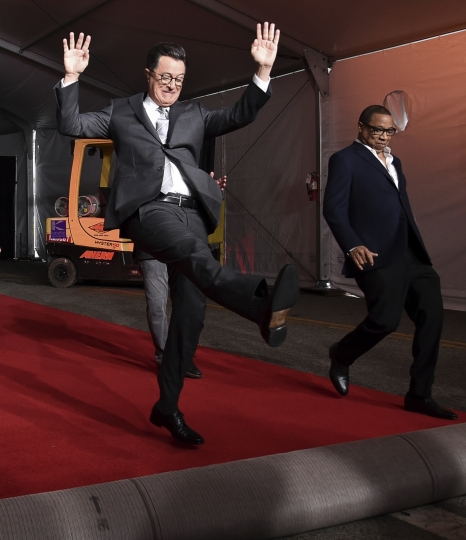 Stephen Colbert, left, and Hayma Washington participate in the 2017 Primetime Emmy Red Carpet Rollout at the Microsoft Theater on Tuesday, Sept. 12, 2017, in Los Angeles. The Emmys will be held on Sunday. (Photo by Richard Shotwell/Invision/AP)