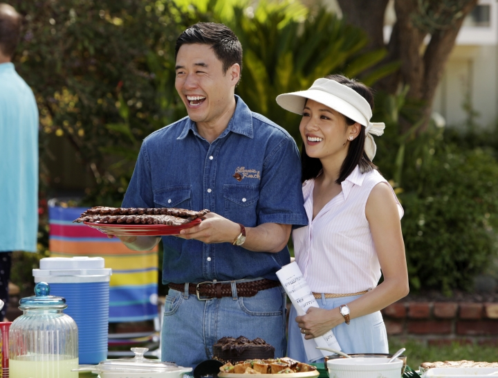 "In this image released by ABC, Randall Park, left, and Constance Wu appear in a scene from the new comedy series ""Fresh Off the Boat."" A new study finds that Asian-American characters are slighted on TV programs despite progress over the last decade. Professors and scholars at six California universities studied 242 broadcast, cable and digital platform shows that aired during the 2015-16 season. Following up on broadcast TV studies done in 2005 and 2005, the new report found increasing opportunities for Asian-American actors in shows including ""Fresh Off the Boat"" and ""Master of None."" (AP Photo/ABC, Nicole Wilder)"
