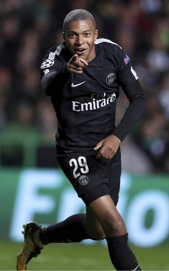 PSG's Kylian Mbappe celebrates after scoring his side's 2nd goal during the Champions League Group B soccer match between Celtic and Paris St. Germain at the Celtic Park stadium in Glasgow, Scotland, Tuesday, Sept. 12, 2017. (AP Photo/Scott Heppell)