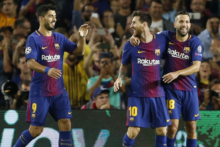 Barcelona's Luis Suarez, left, and Jordi Alba, right, celebrate with Lionel Messi who scored 3-0 during a Champions League group D soccer match between FC Barcelona and Juventus at the Camp Nou stadium in Barcelona, Spain, Tuesday, Sept. 12, 2017. (AP Photo/Francisco Seco)