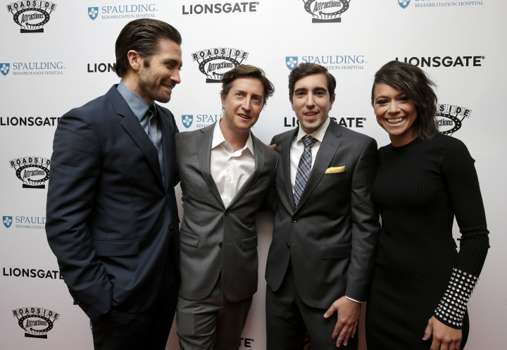 """Actor Jake Gyllenhaal, left, director David Gordon Green, center left, Boston Marathon bombing survivor Jeff Bauman, center right, and actress Tatiana Maslany, right, arrive on the red carpet Tuesday, Sept. 12, 2017, at the U.S. premiere of the movie """"Stronger"""" at the Spaulding Rehabilitation Hospital in Boston. The U.S. premiere of the film that chronicles the story Bauman. Gyllenhaal plays Bauman, while Maslany plays Bauman's then-girlfriend Erin Hurley in the film. (AP Photo/Steven Senne)"""