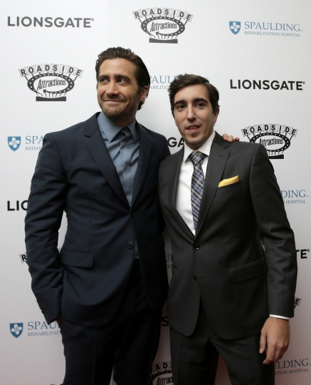 """Actor Jake Gyllenhaal, left, and Boston Marathon bombing survivor Jeff Bauman, right, arrive on the red carpet Tuesday, Sept. 12, 2017, at the U.S. premiere of the movie """"Stronger"""" at the Spaulding Rehabilitation Hospital in Boston. The U.S. premiere of the film that chronicles the story of Bauman took place at the hospital where he and others who were injured in the 2013 deadly attack were treated. Gyllenhaal plays Bauman in the film. (AP Photo/Steven Senne)"""