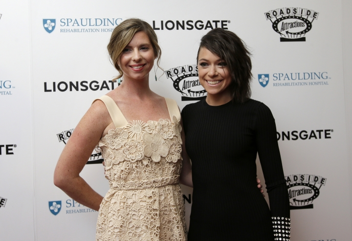"""Erin Hurley, left, and actress Tatiana Maslany, right, arrive on the red carpet Tuesday, Sept. 12, 2017, at the U.S. premiere of the movie """"Stronger"""" at the Spaulding Rehabilitation Hospital in Boston. The premiere of the film that chronicles the story of Boston Marathon bombing survivor Jeff Bauman took place at the hospital where he and others who were injured in the 2013 deadly attack were treated. Bauman was waiting for then-girlfriend Hurley, who was running in the race when the 2013 bombing took place. Maslany plays Hurley in the film. (AP Photo/Steven Senne)"""