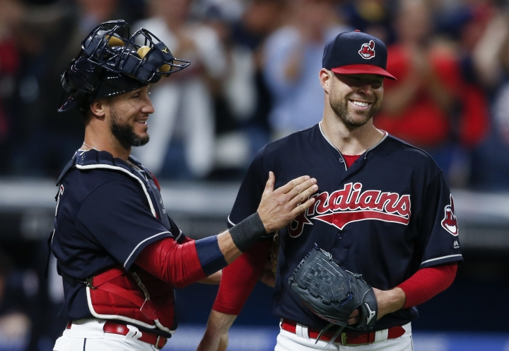 Cleveland Indians starting pitcher Corey Kluber, right, and catcher Yan Gomes celebrate a 2-0 victory over the Detroit Tigers in a baseball game, Tuesday, Sept. 12, 2017, in Cleveland. (AP Photo/Ron Schwane)