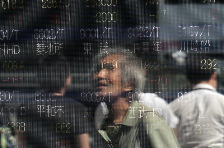 A man is reflected on an electronic stock indicator of a securities firm in Tokyo, Wednesday, Sept. 13, 2017. Most Asian stock markets were higher Wednesday after U.S. shares rose on encouraging jobs data while worries about North Korea and twin hurricane disasters eased. (AP Photo/Shizuo Kambayashi)