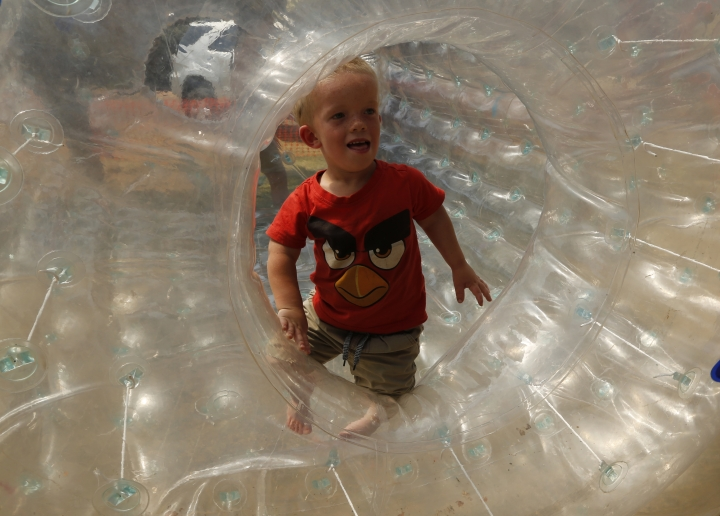 Winner of a Mr. Dwarf competition, Adriaan Coetzee, plays in a plastic air bubble during a weekend dwarf festival in Modimolle, South Africa, Saturday, Sept. 9, 2017. The event this past weekend drew dwarves from around the country and was an opportunity to share experiences, and discuss challenges and ways to overcome them. (AP Photo/Denis Farrell)