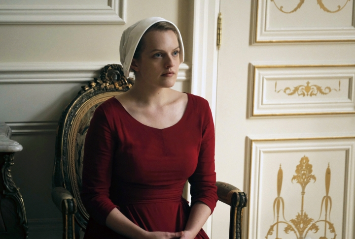 "This image released by Hulu shows Elisabeth Moss as Offred in a scene from, ""The Handmaid's Tale."" The program is nominated for an Emmy Award for outstanding drama series. The Emmy Awards ceremony, will air on Sept. 17. (George Kraychyk/Hulu via AP)"