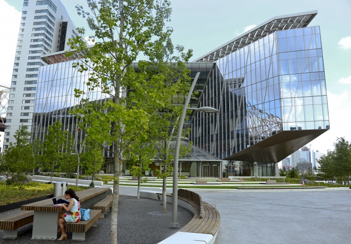 This Wednesday Aug. 16, 2017, photo shows Cornell Tech's 26-story residence hall, left, and a special programs building called the Bridge, right, on the campus of a new graduate school collaboration between Cornell University and the Technion-Israel Institute of Technology on Roosevelt Island in New York. (AP Photo/Bebeto Matthews)