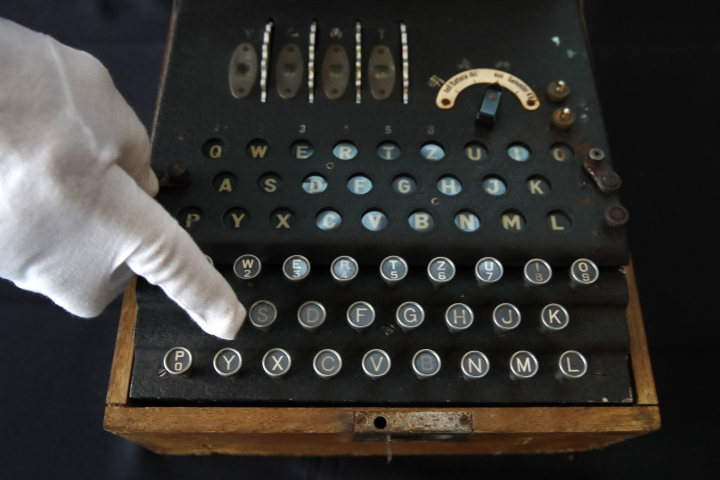 H. Keith Melton points to a key on an Enigma Machine with four rotors and a some Japanese characters that was used in World War II to encode messages, Wednesday, Sept. 13, 2017, in Washington. The machine is one of the many items that he is donating to the International Spy Museum from his collection of spy objects. (AP Photo/Jacquelyn Martin)
