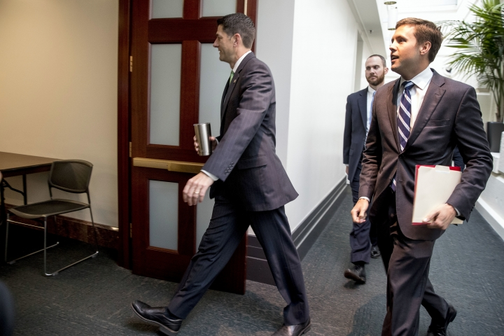 House Speaker Paul Ryan of Wis., center, arrives for a GOP caucus meeting on Capitol Hill, Wednesday, Sept. 13, 2017, in Washington. (AP Photo/Andrew Harnik)