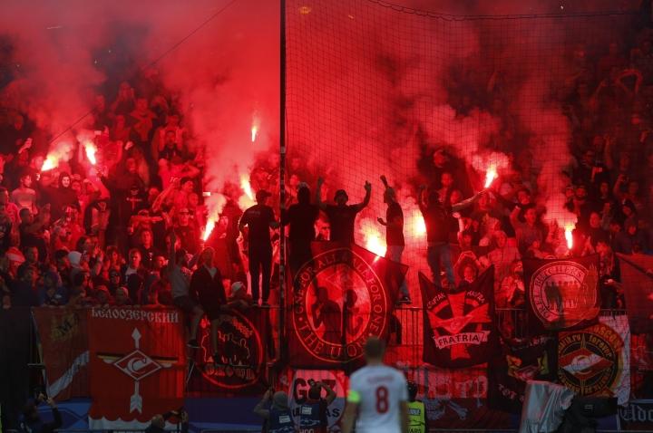 Spartak supporters light a flare during the Champions League soccer match between Maribor and Spartak Moskva at the Ljudski vrt stadium, in Maribor, Slovenia, Wednesday, Sept. 13, 2017. (AP Photo/Darko Bandic)