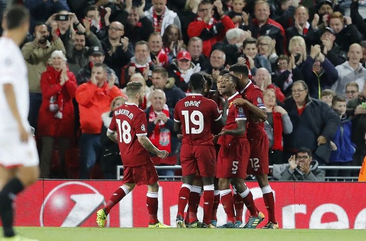 Liverpool's Roberto Firmino, third from right, celebrates with his teammates after scoring during the Champions League group E soccer match between Liverpool and Sevilla at Anfield stadium in Liverpool, England, Wednesday, Sept. 13, 2017. (AP Photo/Frank Augstein)