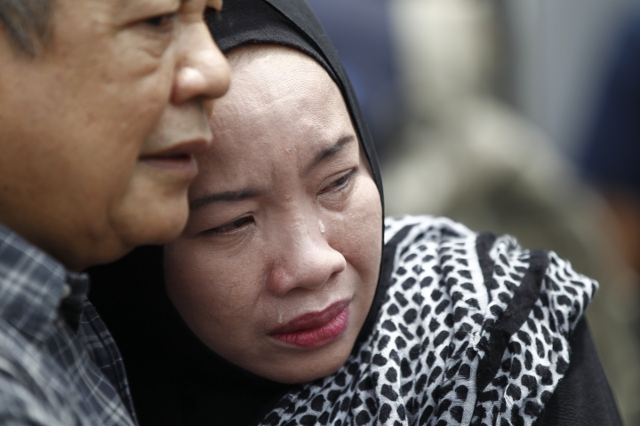 Family members cry outside an Islamic religious school following a fire on the outskirts of Kuala Lumpur Thursday, Sept. 14, 2017. The official said the fire, which killed people, mostly teenagers, started early Thursday at the top floor of the three-story building. (AP Photo/Daniel Chan)