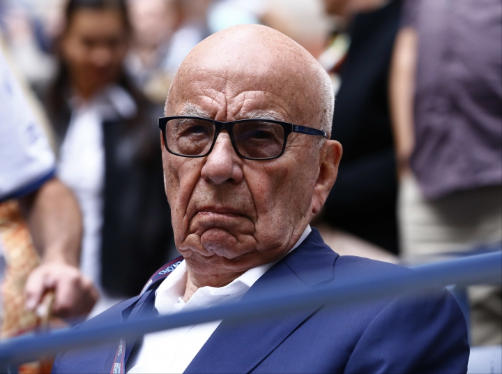 FILE- In this Sunday, Sept. 10, 2017 file photo, Rupert Murdoch waits for the start of the men's singles final of the U.S. Open tennis tournament between Rafael Nadal, of Spain, and Kevin Anderson, of South Africa, in New York. The British government said, Tuesday, Sept. 17, 2017, it is referring Twenty-First Century Fox Inc.'s bid for satellite broadcaster Sky to the country's competition regulator, in a blow to Rupert Murdoch's takeover plans. (AP Photo/Julio Cortez, File)