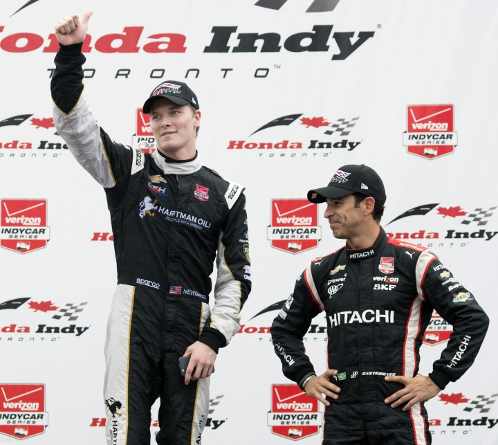 FILE - In this June 14, 2015, file photo, winner Josef Newgarden, left, and teammate and third place Helio Castroneves celebrate on the posium after the Honda Toronto IndyCar race in Toronto. As NASCAR prepares to open its playoffs, the IndyCar Series is ready to crown its champion. Four drivers go into the season finale Sunday at Sonoma Raceway in contention for the title, which is a Penske vs. Ganassi showdown. Josef Newgarden holds a three-point lead in the standings over Ganassi driver Scott Dixon. Newgarden's two Penske teammates are also in striking distance. (Darren Calabrese/The Canadian Press via AP, File)
