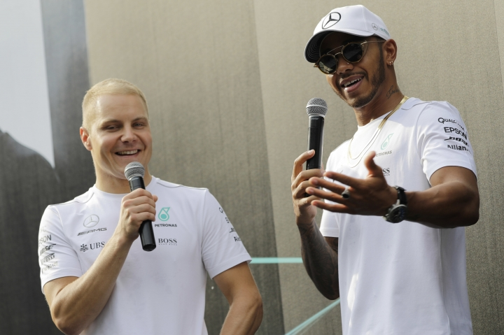Mercedes drivers Lewis Hamilton of Britain, right, and Valtteri Bottas of Finland, speak during an event on Thursday, Sept. 14, 2017 in Singapore, ahead of the Singapore Formula One Grand Prix which will be held on Sunday, Sept. 17, 2017. (AP Photo/Wong Maye-E)