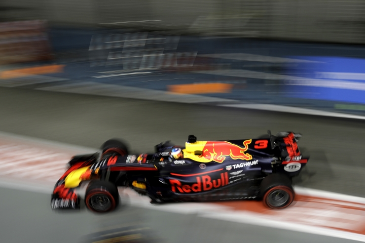 Red Bull driver Daniel Ricciardo of Australia steers his car into the pit lane during the second practice session at the Singapore Formula One Grand Prix on the Marina Bay City Circuit Singapore, Friday, Sept. 15, 2017. (AP Photo/Wong Maye-E)
