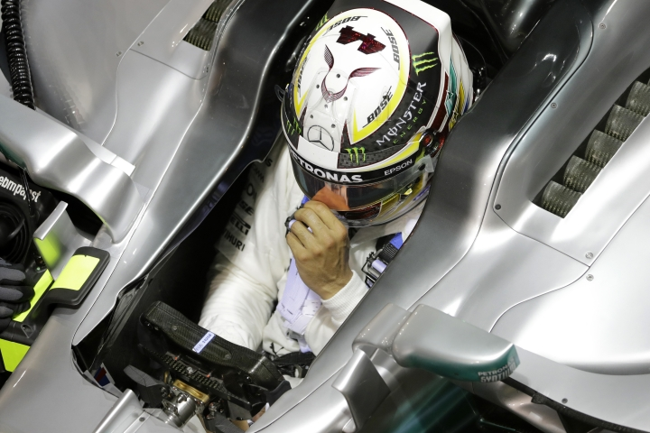 Mercedes driver Lewis Hamilton of Britain returns to his team garage during the second practice session at the Singapore Formula One Grand Prix on the Marina Bay City Circuit Singapore, Friday, Sept. 15, 2017. (AP Photo/Wong Maye-E)