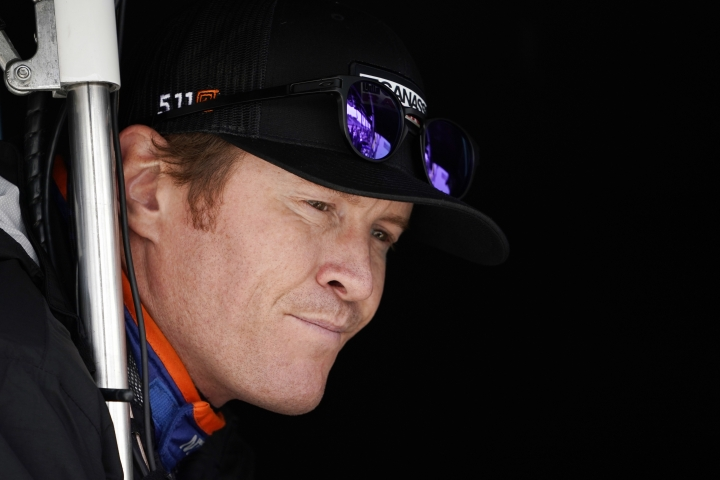 FILE - In this Sept. 1, 2017, file photo, Scott Dixon waits for a practice session for the IndyCar Series auto race in Watkins Glen, N.Y. When Josef Newgarden hit the wall at Watkins Glen, it blew the championship race wide open and gave Dixon a clear shot at the title. If there's one thing a driver should never do, it is give four-time champion Dixon an opening. (AP Photo/Matt Slocum, File)
