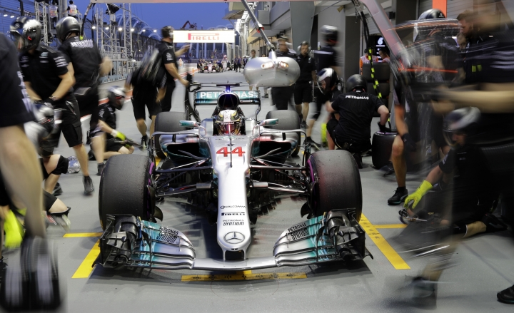 Mercedes driver Lewis Hamilton of Britain sits in his car following the third practice session at the Singapore Formula One Grand Prix on the Marina Bay City Circuit Singapore, Saturday, Sept. 16, 2017. (AP Photo/Wong Maye-E)