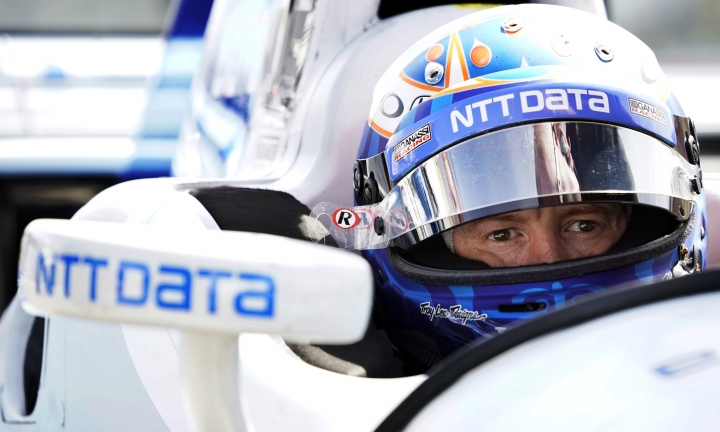 FILE - In this Sept. 1, 2017, file photo, Scott Dixon sits in his car before a practice session for the IndyCar Series auto race in Watkins Glen, N.Y. When Josef Newgarden hit the wall at Watkins Glen, it blew the championship race wide open and gave Dixon a clear shot at the title. If there's one thing a driver should never do, it is give four-time champion Dixon an opening. ((AP Photo/Matt Slocum, File)