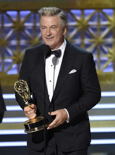 "Alec Baldwin accepts the award for outstanding supporting actor in a comedy series for ""Saturday Night Live"" at the 69th Primetime Emmy Awards on Sunday, Sept. 17, 2017, at the Microsoft Theater in Los Angeles. (Photo by Chris Pizzello/Invision/AP)"
