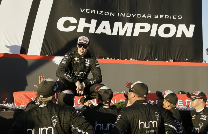 Josef Newgarden talks with his crew after winning the IndyCar championship Sunday, Sept. 17, 2017, in Sonoma, Calif. (AP Photo/Eric Risberg)