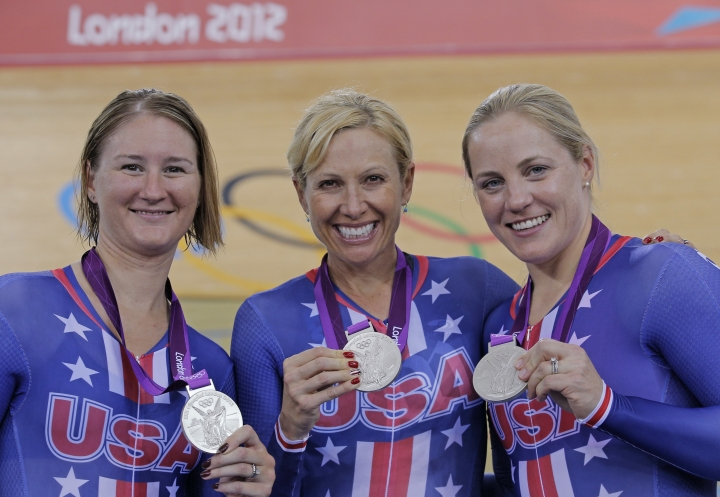 FILE - In this Aug. 4, 2012, file photo, Jennie Reed, left, Sarah Hammer, center, and Laurie Tamayo, right, of the United States show their silver medals for the track cycling women's pursuit team event during the 2012 Summer Olympics in London. Three-time Olympian Sarah Hammer, one of the most decorated track cyclists in U.S. history, is retiring after a prolific career spanning more than two decades. The 34-year-old Hammer announced Monday, Sept. 18, 2017, that she's stepping away from competitive riding to focus on the training facility that she founded in Colorado Springs with her coach and husband, Andy Sparks. (AP Photo/Christophe Ena, File)