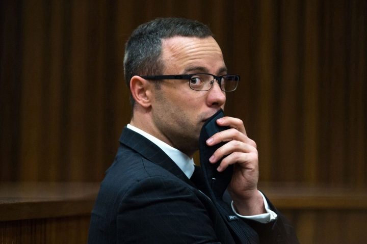 FILE - In this photograph taken on Tuesday, May 19, 2014, Oscar Pistorius listens to psychiatric evidence for his defense, during his ongoing murder trial in Pretoria, South Africa. Pistorius faces another legal challenge when South Africa's Supreme Court of Appeal convenes Nov. 3, 2017 to hear arguments by state prosecutors that the former track star and convicted murderer should get more jail time. (AP Photo/Daniel Born, Pool, File)