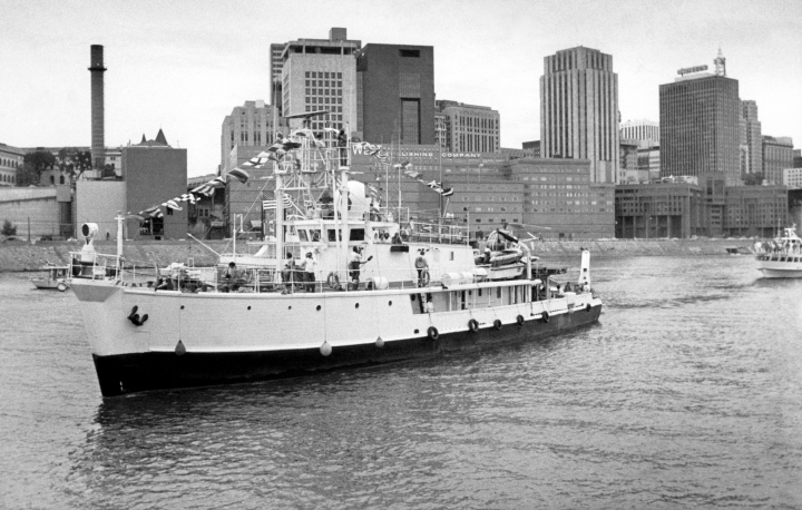 FILE - In this Sept. 10, 1983 file photo, Jacques Cousteau's research vessel, the Calypso, makes its way past downtown St. Paul to a berth at Harriet Island, Minnesota. A fire on marine explorer Jacques Cousteau's iconic ship, Calypso, has delayed the vessel's restoration by between six to eight months, the Cousteau Society said Wednesday, Sept. 20, 2017. The fire only damaged the ship's newly fitted portions, and the damage will not derail the restoration of the ship, which was due to be completed in early 2019. (AP Photo/IS, file)