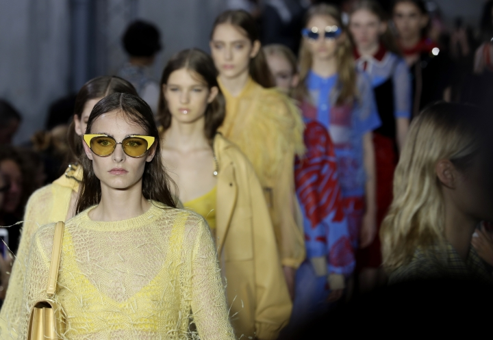 Models wear creations part of N21 women Fall/Winter 2018/19 fashion collection, presented in Milan, Italy, Wednesday, Sept. 20, 2017. (AP Photo/Antonio Calanni)