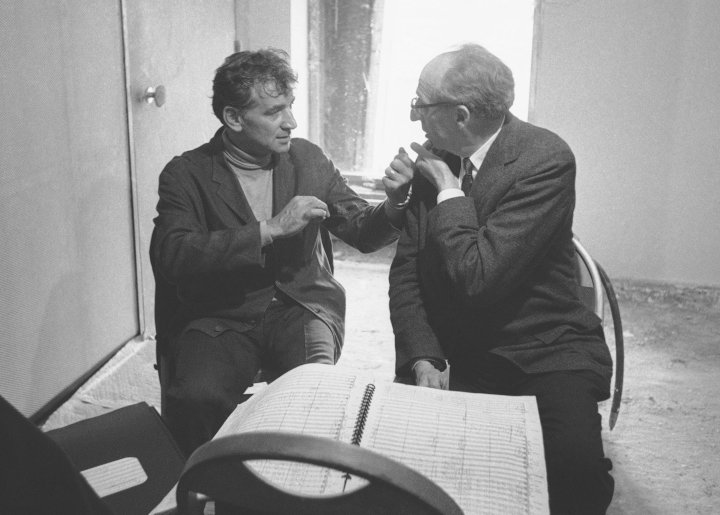 """FILE - In this Sept. 21, 1962 file photo conductor Leonard Bernstein, left, and composer Aaron Copland, right, retire to a room backstage during a break in rehearsal to iron out details in the Copland composition """"Connotations for Orchestra,"""" in New York. Bernstein would have turned 100 next year - a remembrance that's being celebrated in the composer-conductor's Massachusetts birthplace. The Boston Symphony Orchestra kicks off its new season Friday, Sept. 22, 2017, with a concert devoted entirely to America's most famous maestro. (AP Photo/Jacob Harris, File)"""