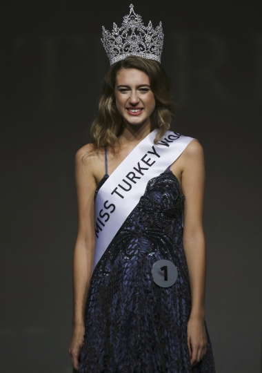"In this photo taken on Thursday, Sept. 21, 2017, Itir Esen, 18, smiles after being crowned as Miss Turkey 2017 in Istanbul. Organizers have stripped Miss Turkey 2017 of her crown over a social media posting that was deemed insulting to the memory of some 250 people who were killed while opposing last year's failed military coup. Miss Turkey organizers said Esen was dethroned on Friday - a day after she won the contest and the right to represent Turkey at the Miss World contest in China - over a tweet they described as ""unacceptable."" (AP Photo)"