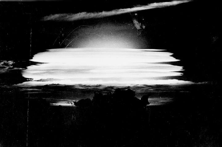 FILE - In this May 20, 1956, file photo provided by the Atomic Energy Council, the sky near Bikini Atoll in the Pacific is a study in black and white as the fireball from the airplane dropped H-bomb silhouette clouds in the foreground at dawn. The world is wondering if North Korea's next nuclear test will involve a nuclear missile screaming over Japan after the North said it may test a hydrogen bomb in the Pacific Ocean. (AP Photo/Atomic Energy Council, File)