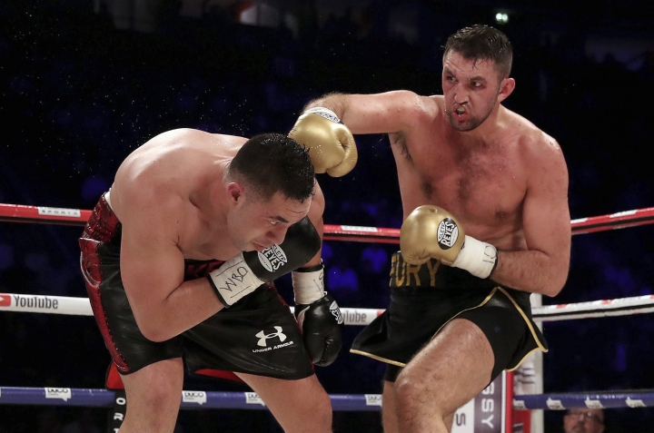 Britain's Hughie Fury, right, battles New Zealand's Joseph Parker during the WBO heavyweight title bout Saturday, Sept. 23, 2017 at Manchester Arena in Manchester, England. (Nick Potts/PA via AP)